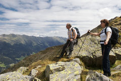 Hiker enjoying stunning view of the Alps Stock Photography