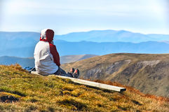Hiker enjoying valley view from top of a mountain Stock Photos