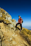 Hiker enjoying view. Hiker enjoying the view from the top of the mountains Stock Images