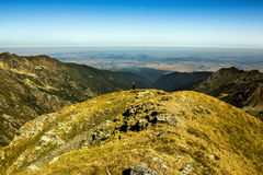 Hiker enjoying view. Hiker enjoying the view from the top of the mountains Stock Photography