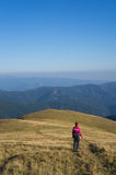 Hiker enjoying the view and going downhill Stock Photo