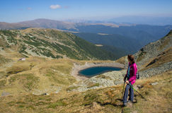 Hiker enjoying the view near a lake Stock Image