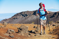 Hiker enjoying walk on amazing mountain trail Stock Image