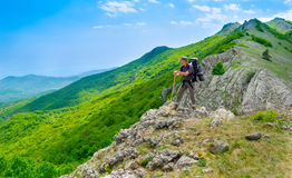Hiker enjoys landscape Royalty Free Stock Image