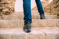 Hiker or Explorer going up on the stairs to archaeological site - Expedition and world explore.  royalty free stock image