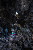 Hiker exploring Indian Tunnel Cave Royalty Free Stock Photos