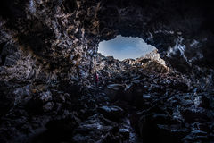 Hiker exploring Indian Tunnel Cave Royalty Free Stock Images