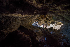 Hiker exploring Indian Tunnel Cave Royalty Free Stock Photography