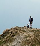 Hiker and Faithful Companion. This image of the hiker with the australian shepherd was taken on Mt Aeneas in NW Montana Royalty Free Stock Image