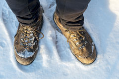 Hiker feet and boots on snowy trail stock photography