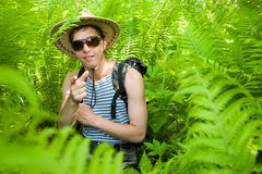 Hiker & ferns Royalty Free Stock Image