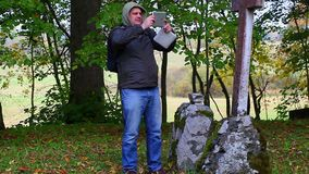 Hiker filmed with tablet PC stock video