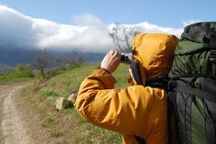 Hiker filming scenery. Stock Images