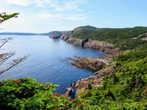 A hiker fist pumping while hiking the east coast trail off the coast of Newfoundland and Labrador, Canada. royalty free stock photography