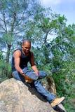 Hiker Fixing Shoe Stock Photo
