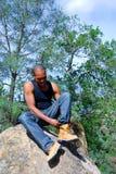 Hiker Fixing Shoe Royalty Free Stock Photo