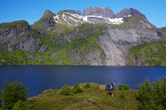 Hiker by fjord in Norway Royalty Free Stock Images