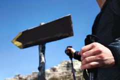 Hiker follow the signs to reach the top of the mountain Stock Image