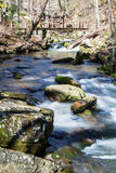 Hiker Footbridge over a Cascading Mountain Stream. Hiker Footbridge over a wild mountain trout stream located in the mountains of Western Virginia, USA Royalty Free Stock Photos