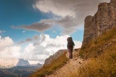 Hiker on footpath Sella Ronda mountain south Tyrol Royalty Free Stock Image