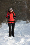 Hiker in forest. Hiker on the snow in winter forest Royalty Free Stock Image