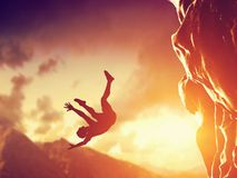 Hiker free falling from the mountain, cliff. Royalty Free Stock Images
