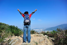 hiker free mountain peak Stock Photo