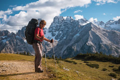 Hiker in front of Alps mountains Stock Photo