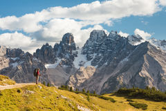 Hiker in front of Alps mountains Royalty Free Stock Photo