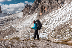 Hiker in front of Alps mountains Royalty Free Stock Photography
