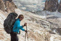 Hiker in front of Alps mountains Royalty Free Stock Photos