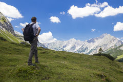 Hiker in front of a rock wall Royalty Free Stock Photo