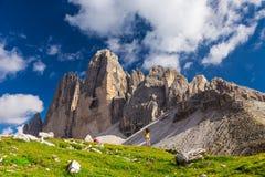 Tre Cime di Lavaredo, Dolomites, Italy. Hiker girl admiring the view over Tre Cime di Lavaredo, Dolomites Mountains, Italy Stock Photos