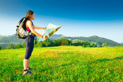 Hiker girl alone looks map Stock Image