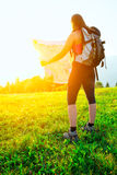 Hiker girl alone looks map Stock Images