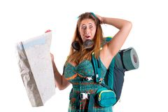 Lost girl with backpack and map stock photo