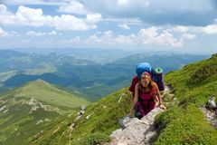 Hiker girl with backpack in mountains Royalty Free Stock Images