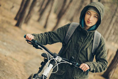 Hiker girl with bicycle Royalty Free Stock Photo