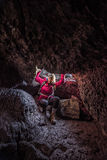 Hiker Girl entering Indian Tunnel Cave Stock Photos