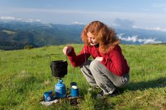 Hiker girl making a coffee Royalty Free Stock Photo