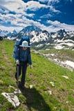 Hiker girl in mountain wally. Stock Photo
