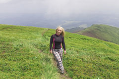 Hiker girl in the mountains Stock Photo