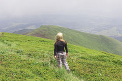 Hiker girl in the mountains Royalty Free Stock Image