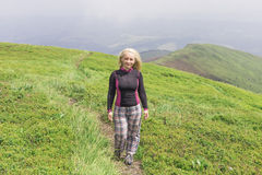 Hiker girl in the mountains Stock Images