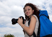 Hiker girl with photo camera Stock Images