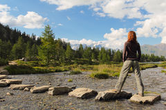 Hiker girl poses on stream stones Royalty Free Stock Photos