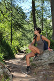 Hiker girl posing on a rock Royalty Free Stock Images