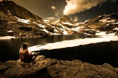 Tourist in Colorado Hiker Girl rests at Blue lake Royalty Free Stock Images