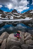 Tourist in Colorado Hiker Girl rests at Blue lake Stock Photos