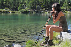 Hiker girl seated on a stone Stock Photography